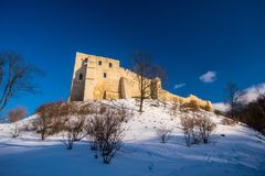 Old castle ruins in a small town Kazimierz Dolny. Old mediaeval castle ruins on a castle hill in Kazimierz Dolny, winter time after snow fall, central Poland Stock Photography