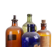 Old medicine bottles. On white Stock Images