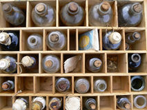 Old Medicine Bottles in a Box. A collection of old medicine bottles with corks in a wooden box stock photography