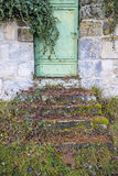Old, medieval abbey wall with door Royalty Free Stock Image