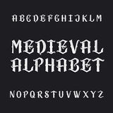 Old medieval alphabet vector font. Distressed type letters on a dark background. Vintage vector typeface for labels, headlines, posters etc Royalty Free Stock Photography