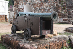Old medieval artillery canon before a brick wall Stock Photography
