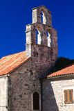 Old medieval bell tower in the old town of Budva Royalty Free Stock Images