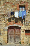 Old medieval building with clothsline hanging at the window Stock Photos
