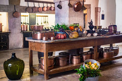 Old medieval castle kitchen with equipment and decoration Royalty Free Stock Image
