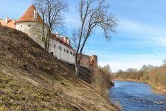 Old medieval castle near river in Bauska town, Latvia Royalty Free Stock Photo