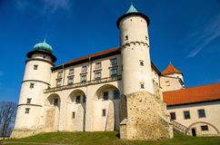 Old medieval castle in Nowy Wisnicz with towers, Poland stock image