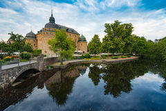 Old medieval castle in Orebro, Sweden, Scandinavia. Europe. Landmark in foreground and blue cloudy sky in background. Architecture and travel Stock Photography