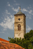 Old medieval church clock tower in Bac Royalty Free Stock Images
