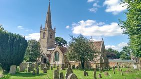 Old english medieval church. Old medieval english church with cemetery stock image