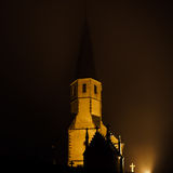 Old medieval church night view, foggy weather Stock Images