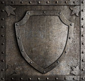 Old medieval coat of arms shield over armour plate Stock Photos