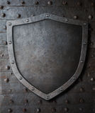 Old medieval coat of arms shield over metal door background Royalty Free Stock Photo