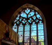 Old medieval colorful leaded-pane windows in gothic style Royalty Free Stock Photo