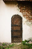 Old medieval door in the destroyed building Stock Photography