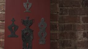 Old medieval door handle and keyhole exhibition in a palace museum. Underground brick catacomb walls stock footage