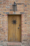 Old medieval door. In the wall Royalty Free Stock Photography