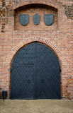 Old medieval door. In the wall Stock Photo