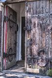 Old medieval double wooden door. Old rustic and aged double wooden door with one door open Stock Images