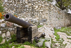 Old medieval era military gun. Situated inside a medieval castle Royalty Free Stock Image