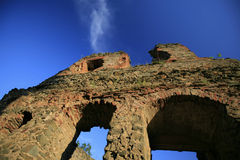 Old medieval fortress ruins in Transylvania. On blue sky Stock Photo