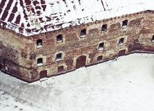 The old medieval fortress stands in the snow stock image