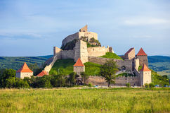 Old medieval fortress on top of the hill, Rupea village located Stock Photos