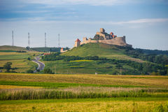 Old medieval fortress on top of the hill, Rupea village located Stock Images