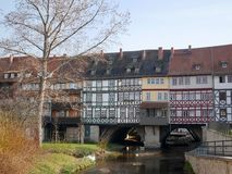 Old medieval half-timbered houses on a bridge Stock Photo