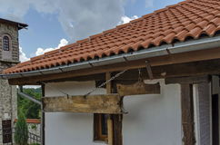 Old medieval house with wooden   and iron  clapper in restored Montenegrin or Giginski monastery. St. St. Cosmas and Damian, mountain  Kitka, Breznik, Pernik Royalty Free Stock Images