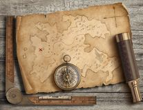 Old medieval island map with compass and spyglass. Adventure and travel concept. 3d illustration. stock photography