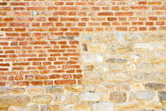 Old medieval italian stone and brick wall. Built with splitted blocks, recently restored Stock Images