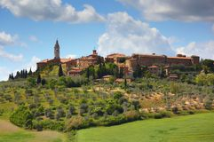 Old italian town on top of hill in Tuscany Stock Photography