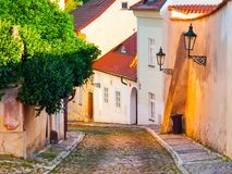 Old medieval narrow cobbled street and small ancient houses of Novy Svet, Hradcany district, Prague, Czech Republic Royalty Free Stock Image
