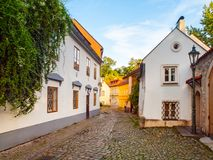 Old medieval narrow cobbled street and small ancient houses of Novy Svet, Hradcany district, Prague, Czech Republic Royalty Free Stock Images