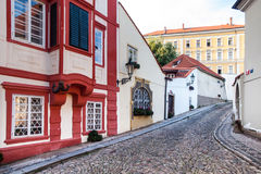 Old medieval narrow cobbled street and small ancient houses of Novy Svet, Hradcany district, Prague, Czech Republic Stock Photo
