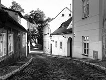 Old medieval narrow cobbled street and small ancient houses of Novy Svet, Hradcany district, Prague, Czech Republic Royalty Free Stock Photos