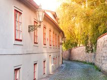 Old medieval narrow cobbled street and small ancient houses of Novy Svet, Hradcany district, Prague, Czech Republic Royalty Free Stock Photography