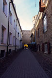 Old medieval Narrow Street in Tallinn, a perspective view, Estonia Royalty Free Stock Image