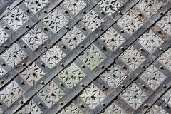Old, medieval pattern. On steel door Stock Photos