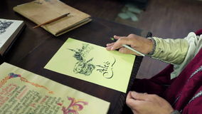 An old medieval scholar subscribing himself in calligraphic writing stock video