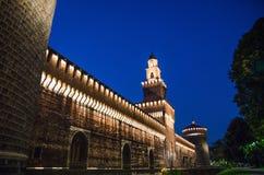 Old medieval Sforza Castle Castello Sforzesco lightning facade, walls, tower La torre del Filarete in Milan. Old medieval Sforza Castle Castello Sforzesco stock image
