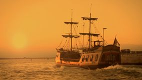 Old medieval ship gracefully sailing to open sea, travelling towards adventures. Stock footage stock video