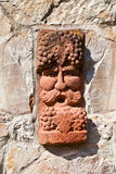 Old medieval stone wall with face of baccus, god of winery. Old medieval stone wall with face of baccus, the god of winery stock image