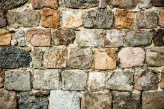 Old medieval stonewall, composed of large massive stone blocks, as abstract seamless texture background Stock Photography