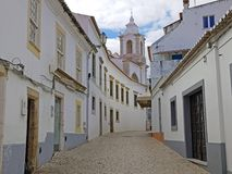 Old medieval street in Lagos with the Maria church in the Algarv Royalty Free Stock Photography