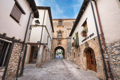 Old medieval street on October 11,2016 in the ancient medieval village of Covarrubias, Burgos, Spain. Stock Photo