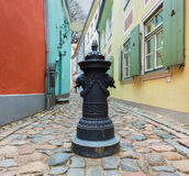 Old medieval street in old Riga city, Latvia Royalty Free Stock Photos