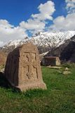 Old medieval tombstone. Against the sky and mountains stock photo
