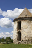 Old medieval tower at Banffy Castle. Old tower that was once a ruin, now shapes-up as it goes through a phase of restoration, together with the whole castle Royalty Free Stock Photos
